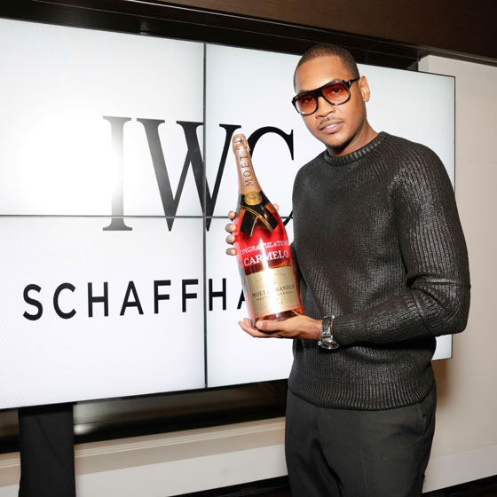 Carmelo-is-presented-with-a-crystalized-bottle-of-Moet-Chandon